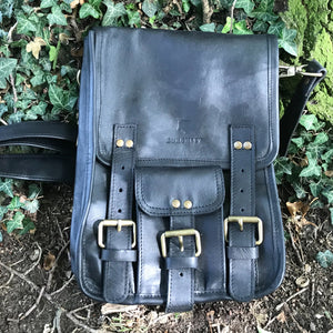 The Barrowby - A retro style hunter's leather satchel by Burghley Bags.  Handmade from soft, vegetable tanned leather. Shown in black and brown.