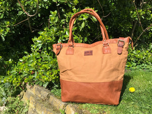 The Bingham.  A classic zipped tote bag by Burghley Bags.  Handmade from eco-friendly vegetable tanned leather and strong cotton canvas, with a leather shoulder strap.  Shown in classic tan.
