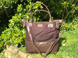 The Bingham.  A classic zipped tote bag by Burghley Bags.  Handmade from eco-friendly vegetable tanned leather and strong cotton canvas, with a leather shoulder strap.  Shown in stylish dark brown.