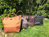 The Bingham.  A classic zipped tote bag by Burghley Bags.  Handmade from eco-friendly vegetable tanned leather and strong cotton canvas, with a leather shoulder strap.  Comes in a variety of colours.