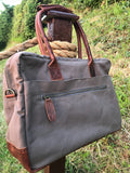 The Breton Briefcase. A casual work bag by Burghley Bags. Handmade from strong cotton canvas and supple leather.  Shown in soft grey.