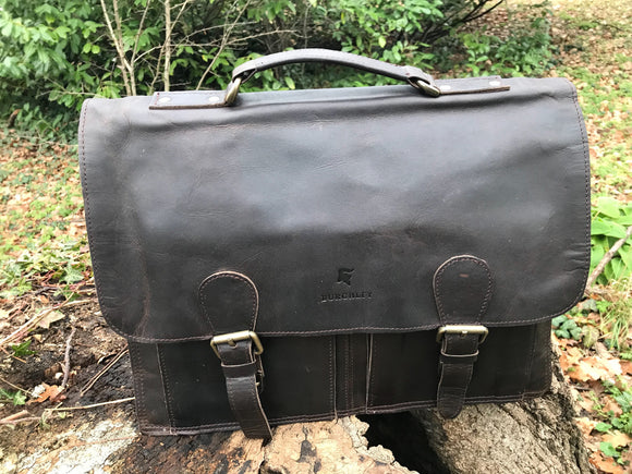 The Burton. A classic leather satchel by Burghley Bags. Handmade from eco-friendly vegetable tanned leather with a vintage look.  Shown in timeless dark brown.