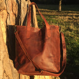 The Casterton. A classic brown leather tote bag with a vintage look by Burghley Bags. Handmade from eco-friendly vegetable tanned leather, with an adjustable and detachable shoulder strap.