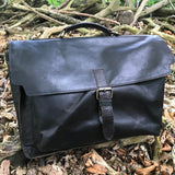 "The Dorrington Briefcase. A classic 30's styled leather briefcase by Burghley Bags. A handmade leather vintage work bag, with enough space for 15"" laptops. Comes with an adjustable and detachable shoulder strap. Shown in elegant black."