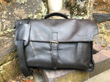 "The Dorrington Briefcase. A classic 30's styled leather briefcase by Burghley Bags. A handmade leather vintage work bag, with enough space for 15"" laptops. Comes with an adjustable and detachable shoulder strap. Shown in classic dark brown."