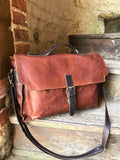 "The Dorrington Briefcase. A classic 30's styled leather briefcase by Burghley Bags. A handmade leather vintage work bag, with enough space for 15"" laptops. Comes with an adjustable and detachable shoulder strap. Shown in striking dual brown."