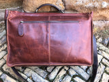 "The Dorrington Briefcase. A classic 30's styled leather briefcase by Burghley Bags. A handmade leather vintage work bag, with enough space for 15"" laptops. Comes with an adjustable and detachable shoulder strap. Striking dual brown back showing zip pocket."