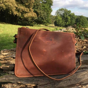 The Clutch Bag. A leather clutch bag Burghley Bags. Handmade from eco-friendly vegetable tanned leather, it comes in classic brown and has a gorgeous vintage look.  The shoulder strap is adjustable and detachable.