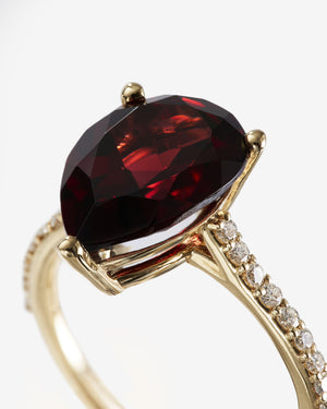 Spessartine Garnet Set 14x9mm (Approx. 4 carats)  in Yellow Gold Setting With Diamonds