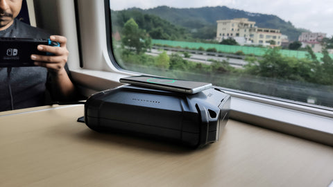image to show soul power poertable charger being charged by 15w wireless charging on a train