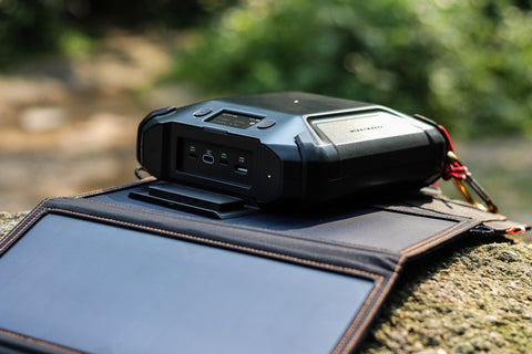 image of soul power portable charger being charged via solar energy power panels