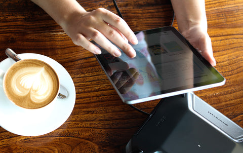 image showing soul power being used to charge a tablet and laptop for work and a coffee