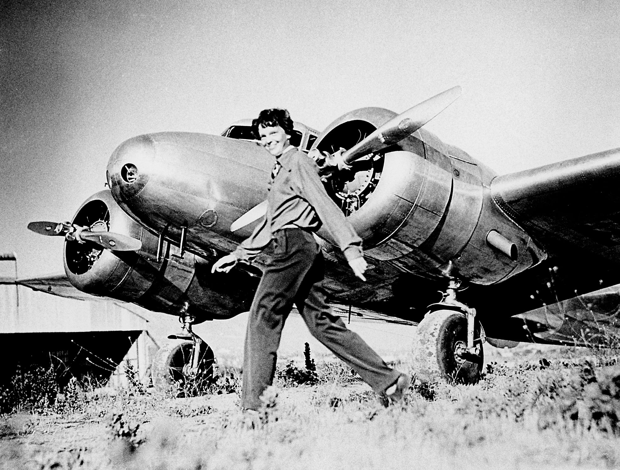 One of the first women aviators, Amelia Earhart broke many records as the first woman to cross the Atlantic alone