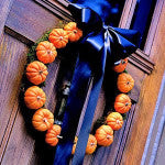 Hang a wreath of gourds for a weird welcome to your guests