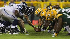 Seahawks and the Packers lining up at the scrimmage line