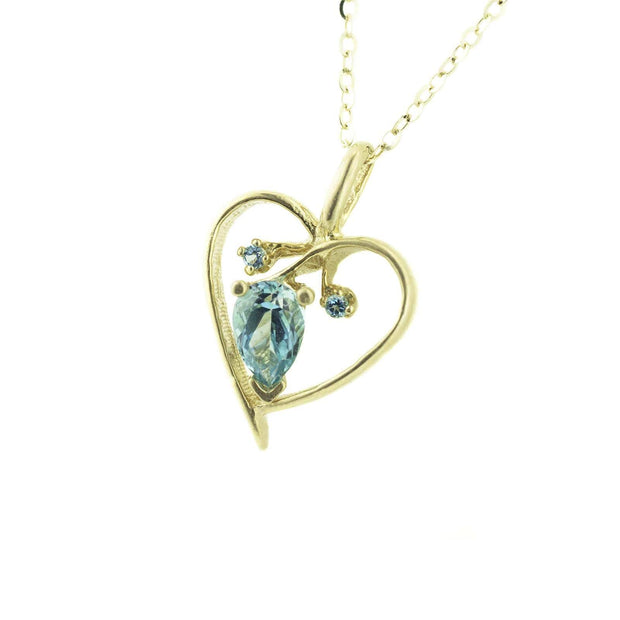 blue topaz necklace, blue topaz heart necklace, blue topaz charm, heart necklace, heart charm, gold heart necklace, gems and jewels