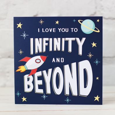 "Space themed Valentines, anniversary card. Dark Blue Background white lettering ""I Love You to Infinity and Beyond, Design uncludes spaceship, stars and planet"