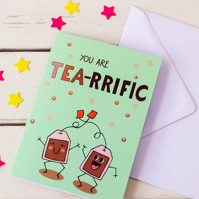 illustrated card of happy, dancing tea bags with words You Are Tea-Rrffic with white envelope. Illustration by fizzi~jayne. fizzy jane