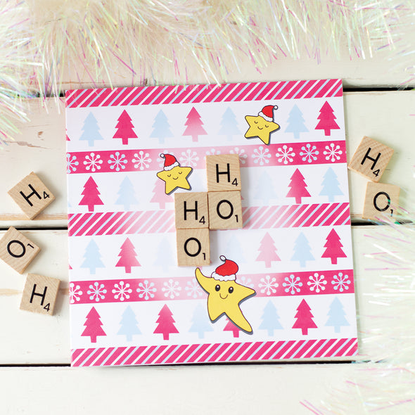 Ho Ho Ho Christmas cards surrounded by tinsel and  wooden scrabble tiles
