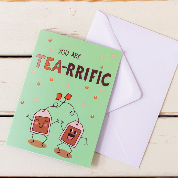 illustrated card of happy, dancing tea bags with words You Are Tea-Riffic with white envelope illustration by fizzy jane