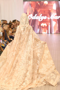 Beige brocade floor-length gown with flowing cape and hood