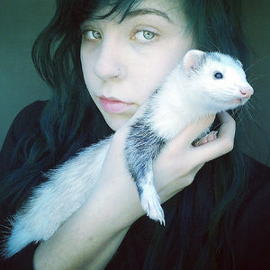 beautiful woman with ferret