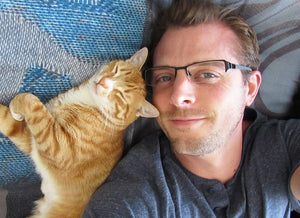 tabby cat with handsome man