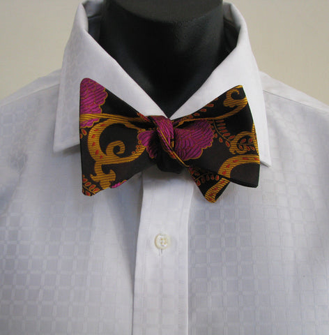 Pink flower on black bow tie