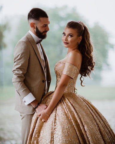 Image of phylliscouture gold wedding dress