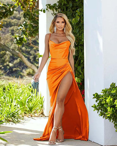 Image of phylliscouture orange prom dress with leg slit
