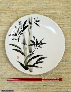 Another angle of  Handmade porcelain dinnerware with sumi-e drawings of a Bamboo
