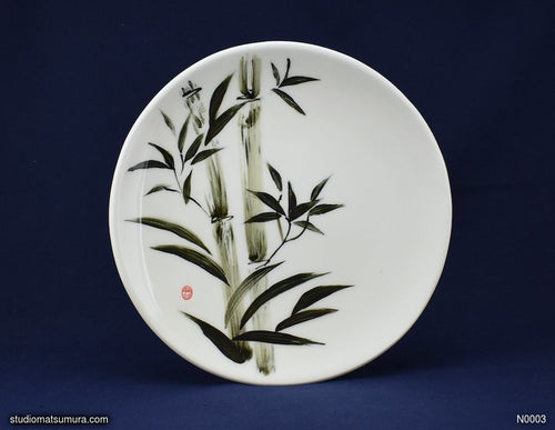 Handmade porcelain dinnerware with sumi-e drawings of a Bamboo