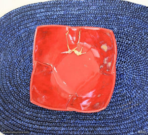 Another angle of  Handmade dinnerware. Origami folding design, stoneware. Brilliant red