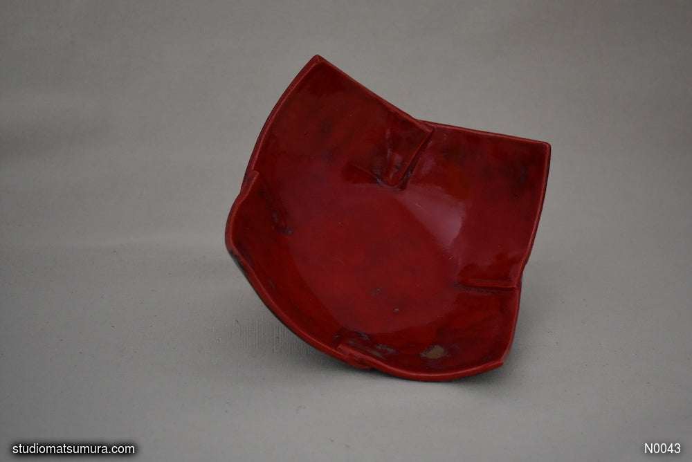 Handmade dinnerware. Origami folding design, stoneware. Brilliant red
