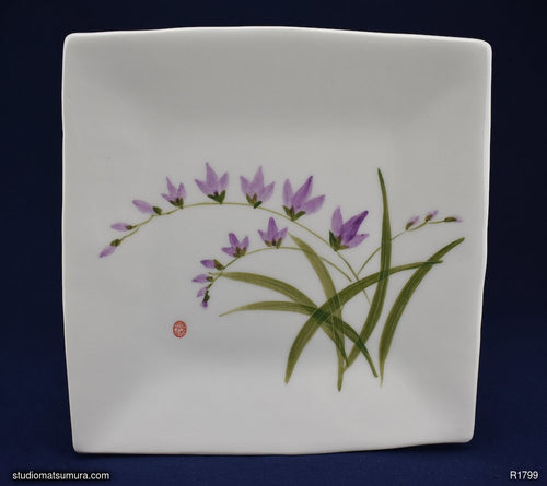 Handmade dinnerware with Sumi-e drawings of a Freesia