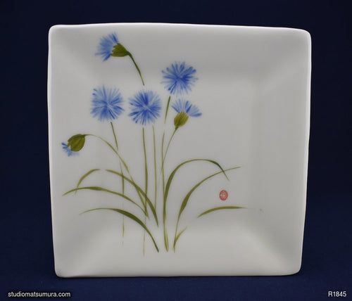 Handmade dinnerware with Sumi-e drawings of a Cupid Flower