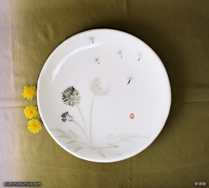 Another angle of  Handmade dinnerware with Sumi-e drawings of a Dandelion