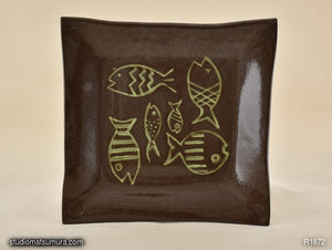 Stoneware dinnerware with fish drawings, handmade
