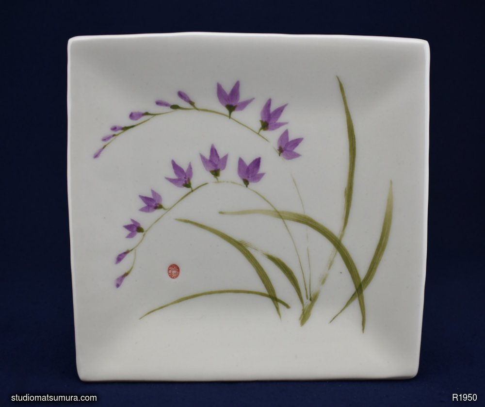 Handmade dinnerware with Sumi-e drawings of a Freesia, variant 2