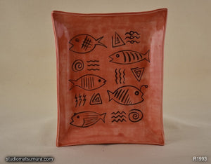 Stoneware dinnerware with fishes and marks drawings, handmade