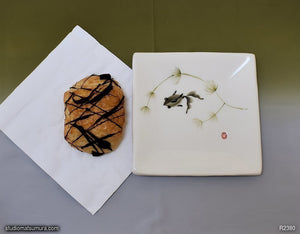 Another angle of  Handmade dinnerware with Sumi-e drawings of a black moor goldfish