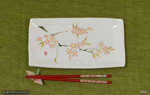 Another angle of  Handmade dinnerware with Sumi-e drawings of a Sakura