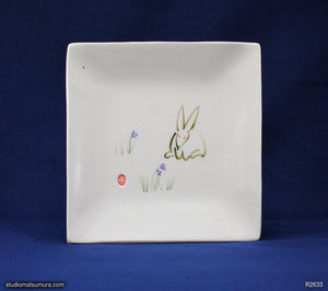 Handmade dinnerware with Sumi-e drawings of a White rabbit