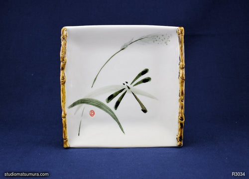 Handmade dinnerware with Sumi-e drawings of a Dragonfly on a grass leaf