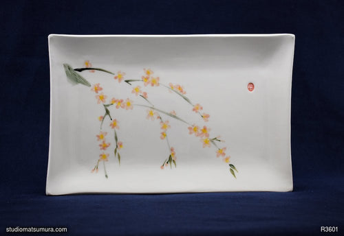 Handmade dinnerware with Sumi-e drawings of a Sakura, landscape orientation
