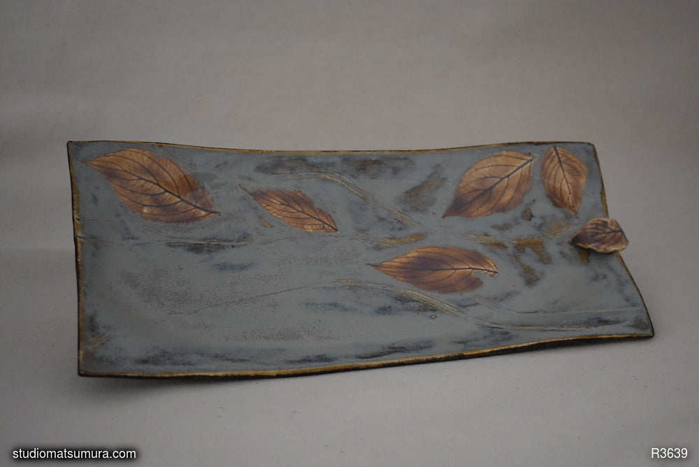 Handmade dinnerware, Dancing leaf design, stoneware, with raised decoration