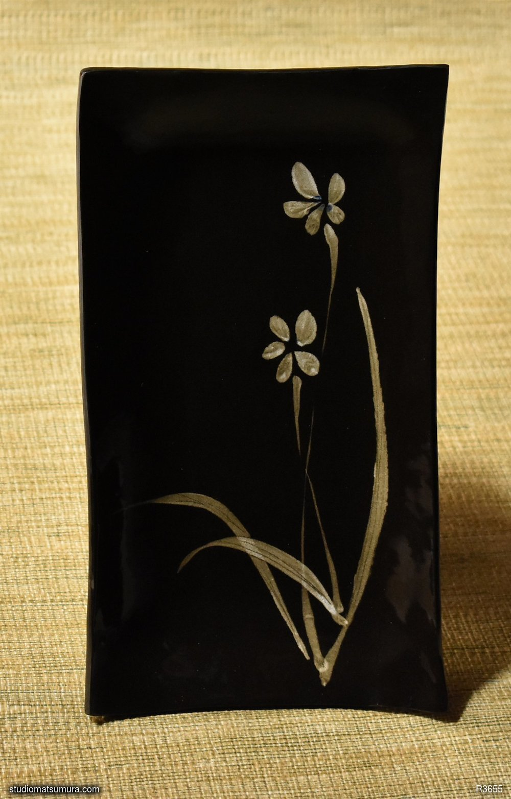 Handmade dinnerware with Sumi-e drawings of a Wild Orchid, on black stoneware