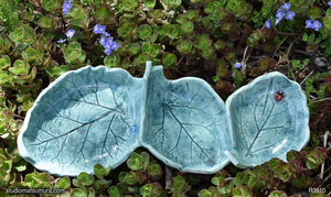 Another angle of  Handmade dinnerware, Three small rhubarb leaves bowl