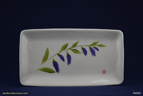 Handmade dinnerware with Sumi-e drawings of a blue Bellflower design