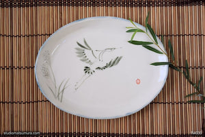 Another angle of  Handmade dinnerware with Sumi-e drawings of a Blue Heron